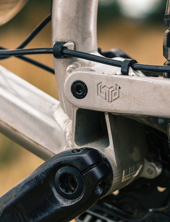 The Bird logo is stamped into the frame of the Bird Aether 9 full suspension mountain bike