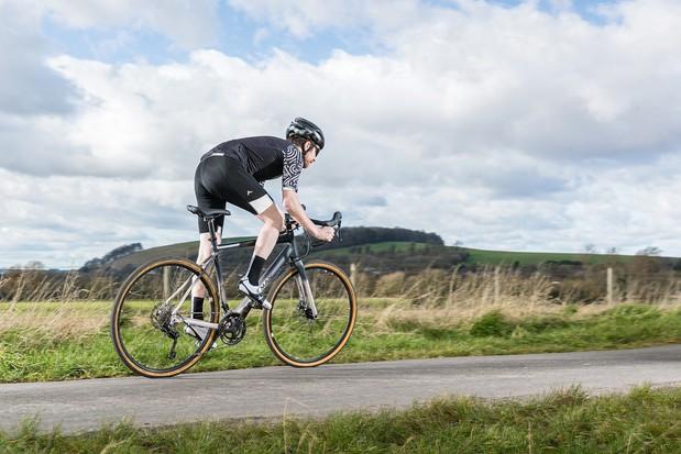 Cyclist in black riding the Boardman ADV 8.9 road bike