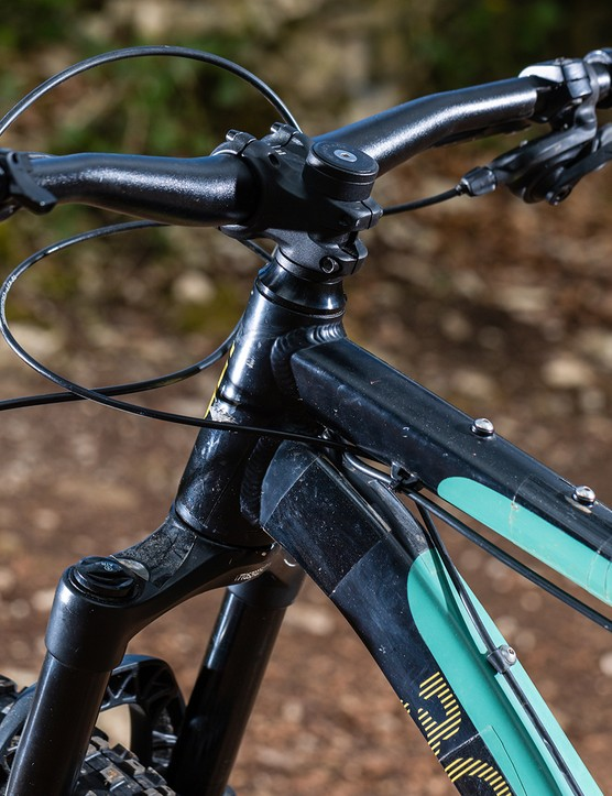 The Bombtrack Cale AL hardtail mountain bike frame is frame is festooned with mounting points for luggage