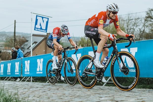 Kasper Asgreen and Mathieu van der Poel riding a cobbled climb