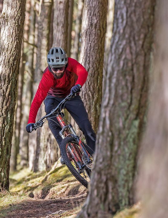 Male cyclist in red top riding the Carrera Fury hardtail mountain bike