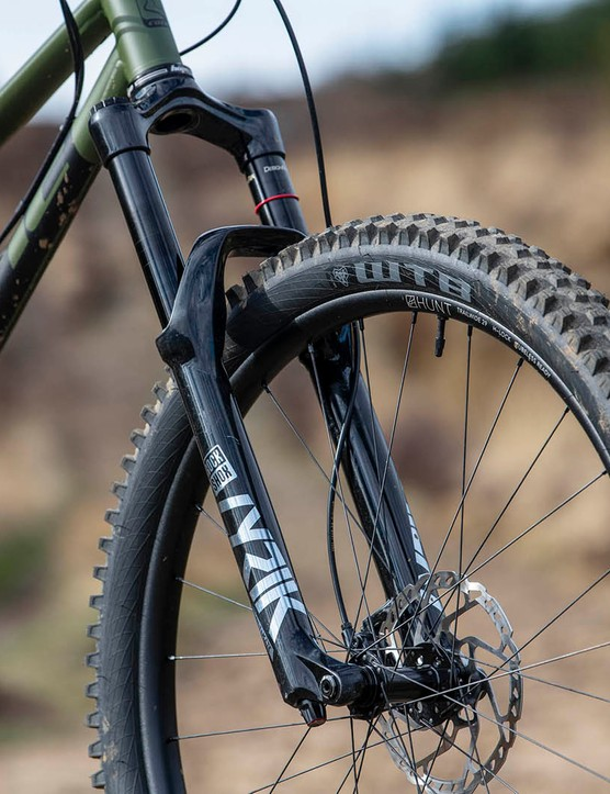 The Cotic RocketMAX Gen3 Silver SLX full suspension mountain bike is equipped with a RockShox Lyrik Ultimate fork