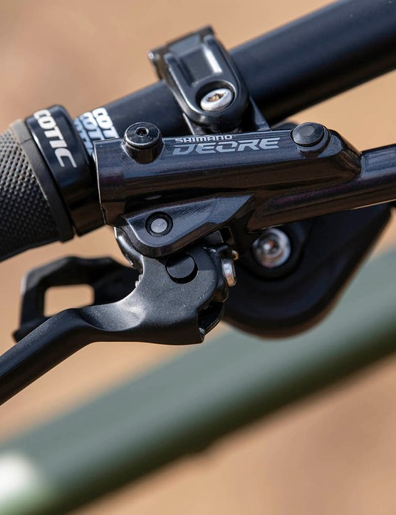 The Cotic RocketMAX Gen3 Silver SLX full suspension mountain bike is equipped with Shimano Deore M6100 brakes