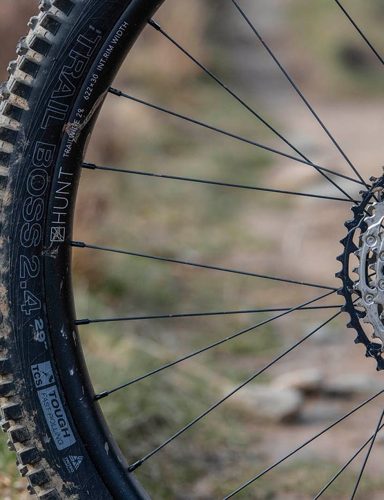 The Cotic RocketMAX Gen3 Silver SLX full suspension mountain bike is equipped with Trail Boss tyre on the rear wheel