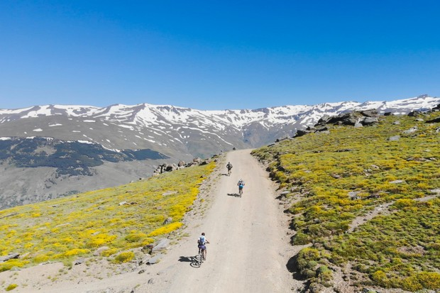 Aerial view of three mountainbikers at Andalucian Sierra Nevada, Spain.