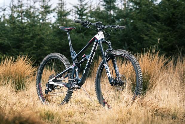 Angled pack shot of the Intense Primer 29 Expert full suspension mountain bike