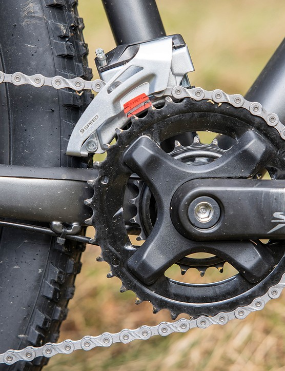 The Specialized Rockhopper Comp hardtail mountain bike has a double front chain ring