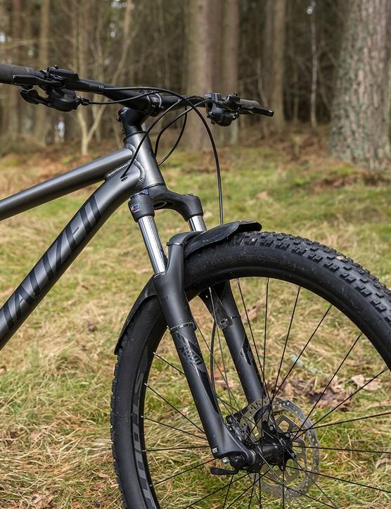 The Specialized Rockhopper Comp hardtail mountain bike has a SR Suntour XCM coil