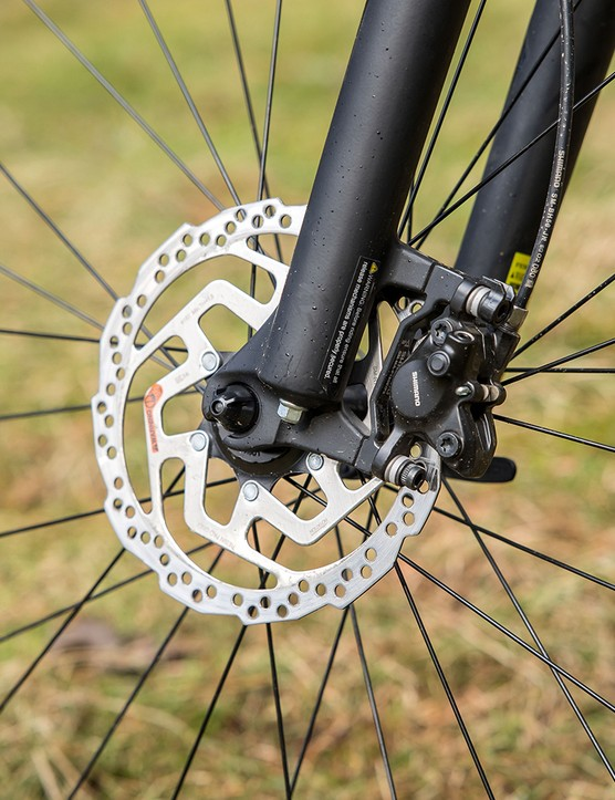 The Specialized Rockhopper Comp hardtail mountain bike has Shimano brakes