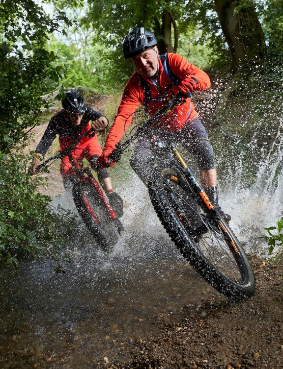 Hans Rey and Rob Warner riding through a stream