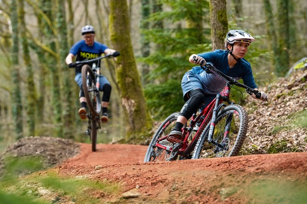 Two cyclists riding the Verderers Blue Trail, Forest of Dean