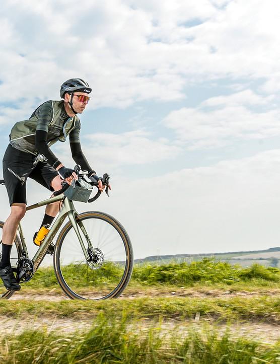 Male cyclist riding the Boardman ADV 9.0 gravel bike