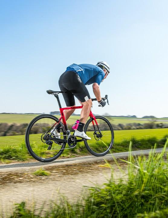 Male cyclist in blue top riding the Boardman SLR 9.4 AXS Disc Carbon - BikeRadar BOTY 2021