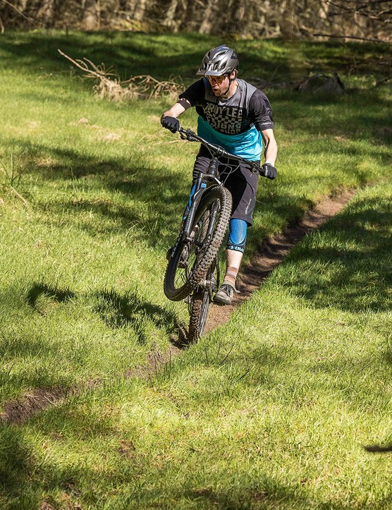Male cyclist in blue and black top riding the Merida Big.Trail 500 hardtail mountain bike