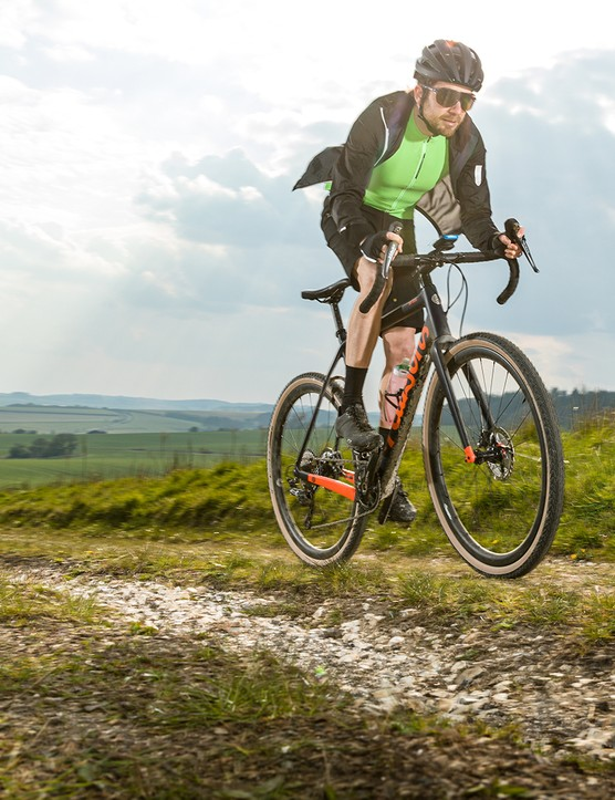 Male cyclist in green top riding the Pearson Off Grid gravel bike