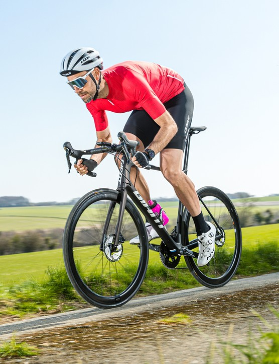 Male cyclist riding the Giant TCR Advanced Pro 1 Disc