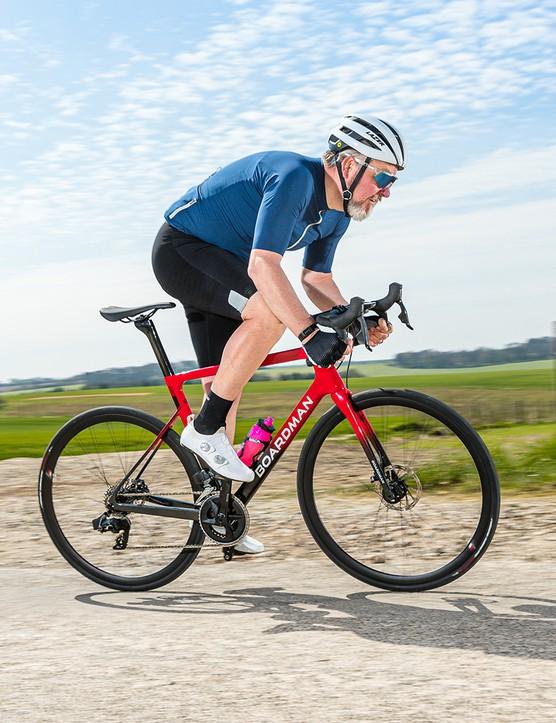 Male cyclist riding the Boardman SLR 9.4 Rival AXS