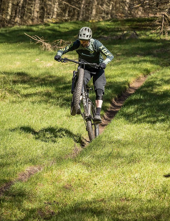 Male cyclist in grey top riding the Specialized Fuse 275 hardtail mountain bike