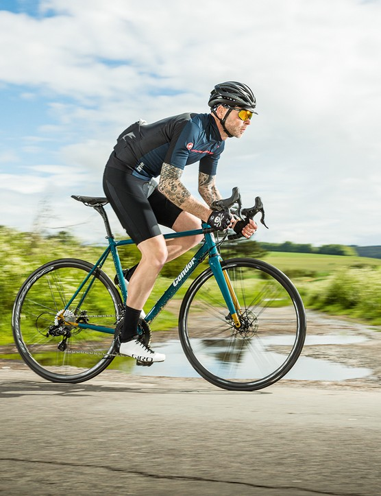 Male cyclist riding the Condor Super Acciaio Disc road bike