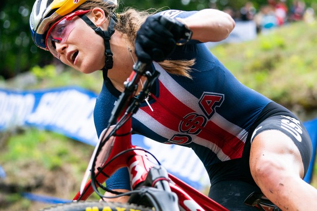 Kate Courtney riding the XC cross-country race at theUCI Mountain Bike World Championships