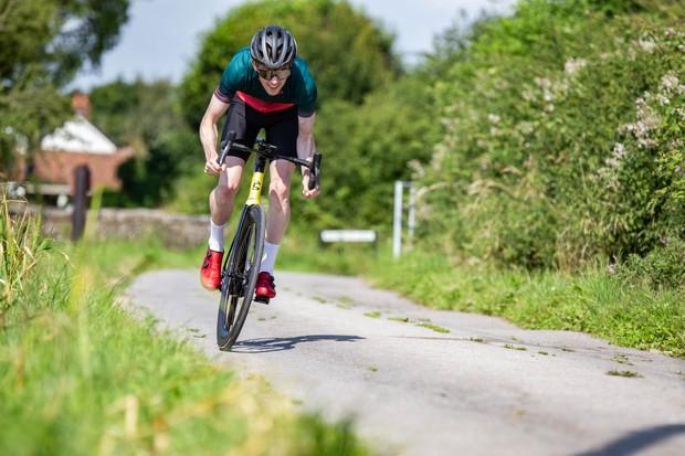 Man cycling hard in aerodynamic position