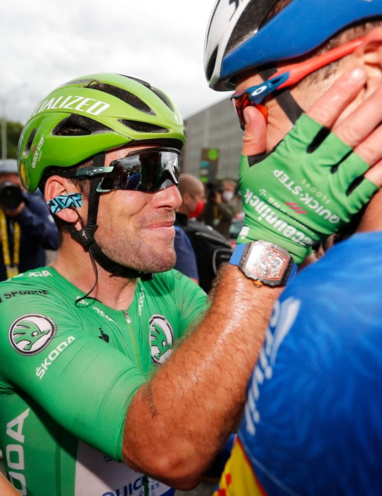 TOPSHOT - Team Deceuninck Quickstep's Mark Cavendish (L) of Great Britain wearing the best sprinter's green jersey celebrates after winning the 10th stage of the 108th edition of the Tour de France cycling race, 190 km between Albertville and Valence, on July 06, 2021. (Photo by Tim VAN WICHELEN / POOL / AFP) (Photo by TIM VAN WICHELEN/POOL/AFP via Getty Images)