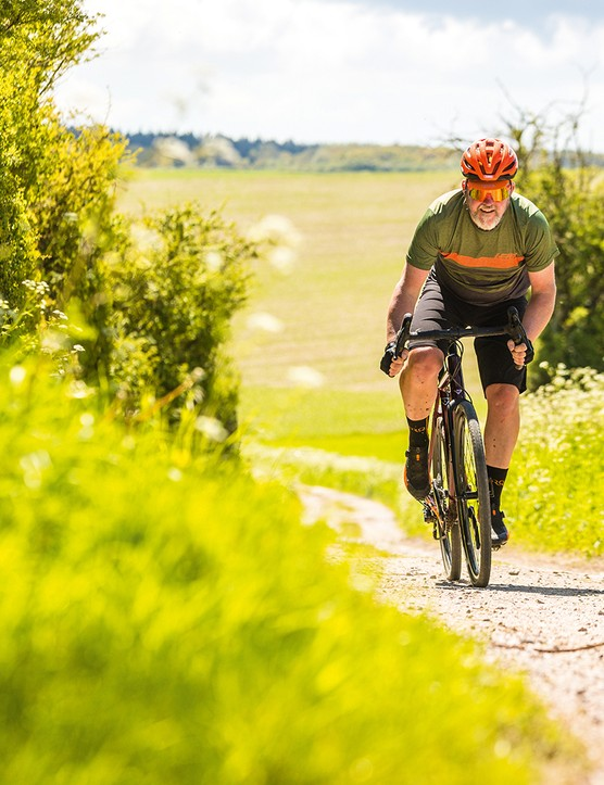 Male cyclist in green top riding the Vaast A/1 gravel bike