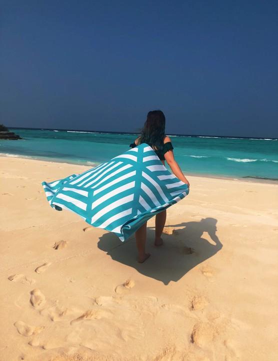 A woman holding a beach towel