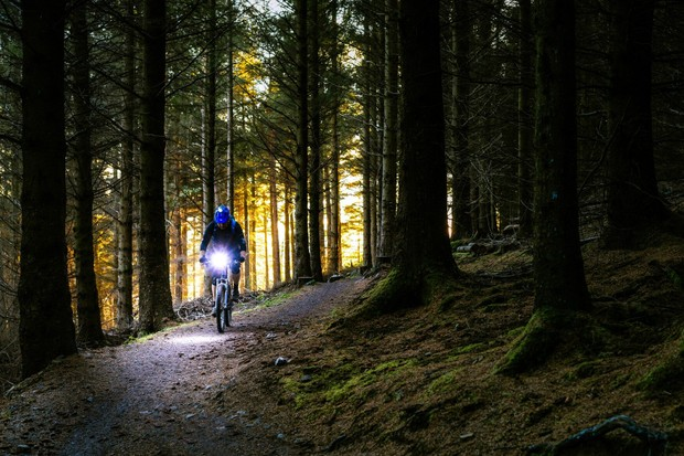 Mountain biker riding with a front light
