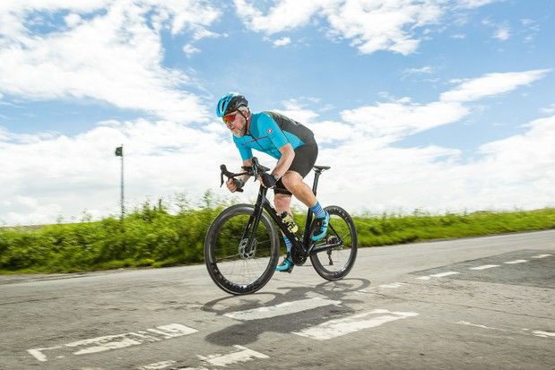 Male cyclist in blue riding the Vitus ZX-1 EVO 105 road bike