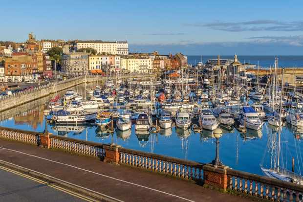 The impressive and historic Royal Harbour of Ramsgate, Kent, Uk, full of leaisure and fishing boats of all sizes and the colourful facade of the historic buildings along the marina promenade