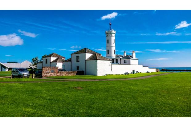 Light house against a blue sky