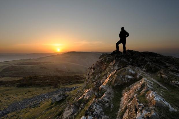 Person on Crook Peak at sunrise, Mendip Hills, Somerset