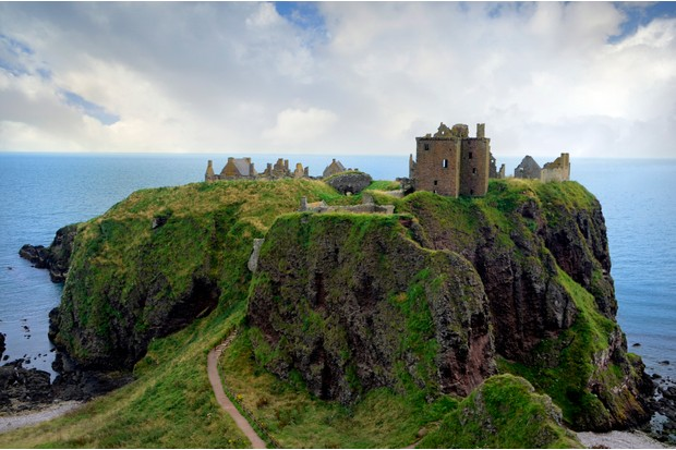 Dunnottar Castle is a ruined medieval fortress located upon a rocky headland on the north east coast of Scotland, about two miles (3 km) south of Stonehaven. The surviving buildings are largely of the 15th 16th centuries, but the site is believed to have been an early fortress of the Dark Ages.