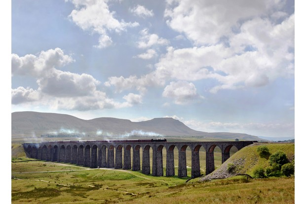 """""""A vintage steam train passes over the Ribblehead viaduct (1874) in North YorkshireEngland, UKIt is the longest and most famous viaduct on the Settle-Carlisle Railway, a railway line passing through some spectacular British scenery. The first stone was laid on 12 October 1870 and the last in 1874"""""""