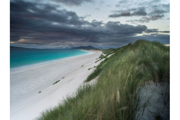 Isle of Berneray (Bearnaraidh). a small island located in the sound of Harris at the nothern tip of North Uist. West Beach with the mountains of Harris in the background. Europe. Scotland. June. (Photo by: Martin Zwick/REDA&CO/UIG via Getty Images)