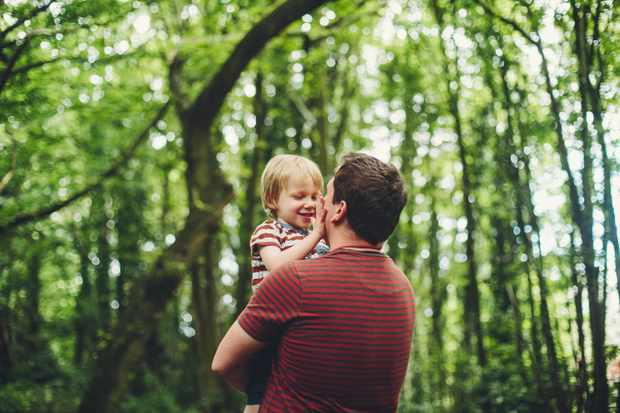 Father and child in woodland