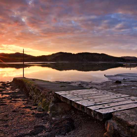 Sunset at Kippford, Dumfries and Galloway showing the River Urr and old Jetty, Scotland