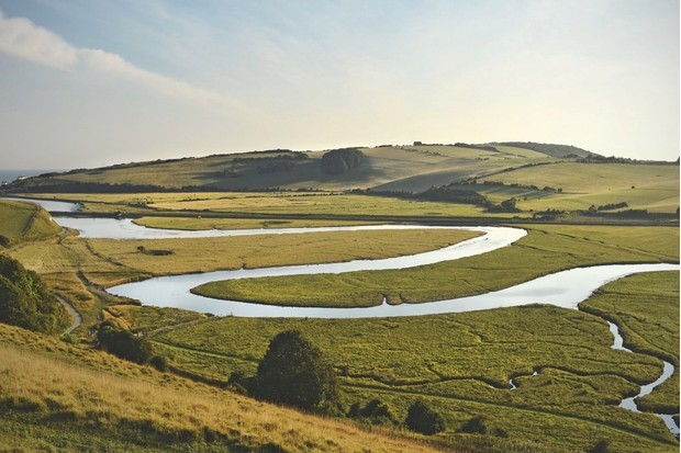 The slow-moving nature of the Cuckmere's lower meanders encourages the deposition of large quantities of fluvial sediment – the raised riverbed, as a result, has left parts of the waterway just a few centimetres deep