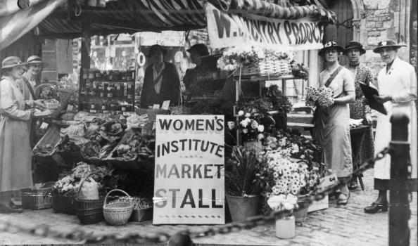 1922:  Members of the Women's Institute manning a West Country produce stall.  (Photo by Evening Standard/Getty Images)