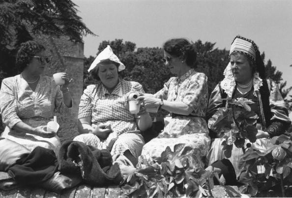 2nd June 1953:  Members of the Women's Institute enjoying a picnic in the grounds of Chilham Castle during the coronation of Queen Elizabeth II. Original Publication: Picture Post - 6557 - The WI - pub. 1953  (Photo by Picture Post/Hulton Archive/Getty Images)