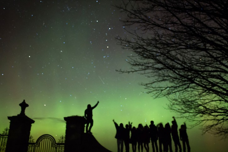 Northern Lights with a shooting star and silhouettes (Aurora Borealis)