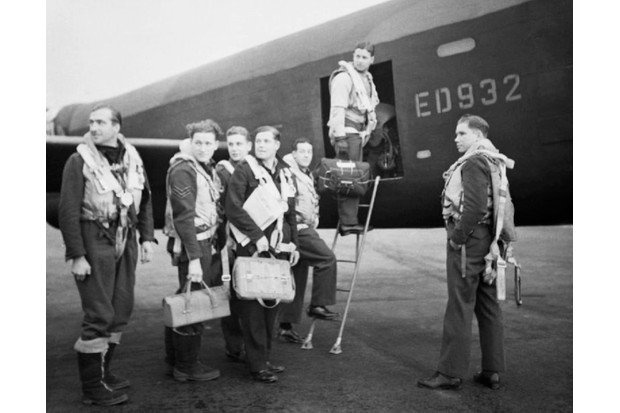 D50T0J Wing Commander Guy Gibson (in door of aircarft) and his crew board their Avro Lancaster bomber for No. 617 Squadron's raid on th