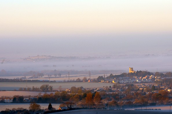 BUCKINGHAMSHIRE, UNITED KINGDOM - DECEMBER 28: The sun catching St Mary's church in Eddlesborough with fog surrounding the area, on December 28, 2016 in Buckinghamshire, England.   A foggy and frosty start to the day. Photo taken looking across Aylesbury Vale from Dunstable Downs as the sun broke through. Picture Shows Ivinghoe Beacon and fog in the valley below just after sunrise.  PHOTOGRAPH BY Tony Margiocchi / Barcroft Images  London-T:+44 207 033 1031 E:hello@barcroftmedia.com - New York-T:+1 212 796 2458 E:hello@barcroftusa.com - New Delhi-T:+91 11 4053 2429 E:hello@barcroftindia.com www.barcroftimages.com (Photo credit should read Tony Margiocchi/Barcroft Images / Barcroft Media via Getty Images)