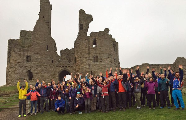 Berghaus-staff-at-Dunstanburgh-Castle-in-Northumberland-testing-kit-during-a-sales-launch-3a34e92