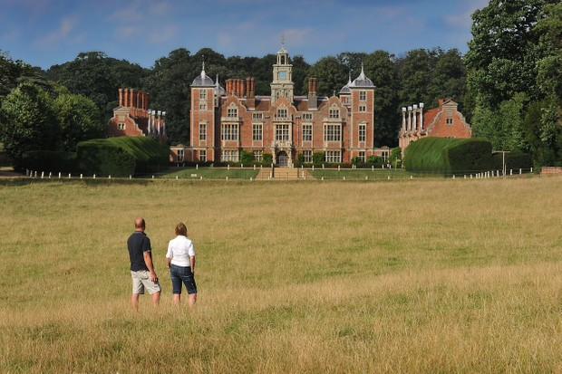 Family in the parkland infront of the house at Blickling Estate, Norfolk.