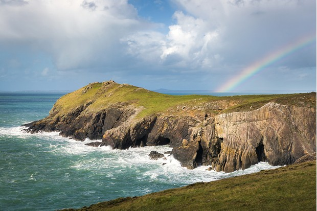 Rainbow above Wooltack Point on the Deer Park in Pembrokeshire, Wales, UK