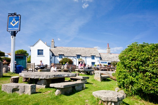 EC23YE Purbeck stone tables and benches outside the Square and Compass pub in the Dorset village of Worth Matravers England UK. Image shot 06/2014. Exact date unknown.
