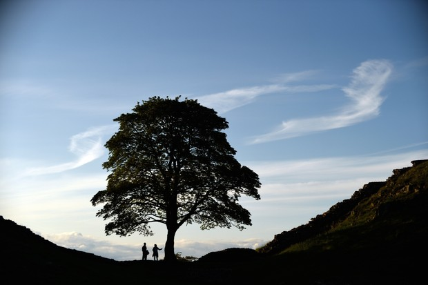 Visitors at Hadrian's Wall and Housesteads Fort, Northumberland. This is one of the Roman Empire's best-maintained outposts in northern Europe.