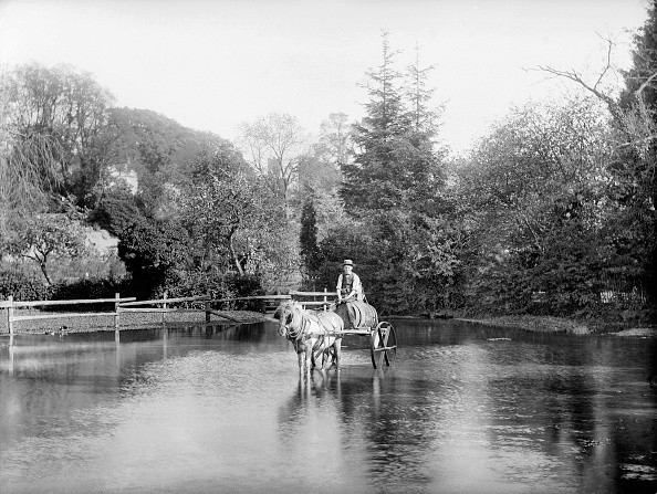 EWELME, Oxfordshire. A young man with a horse and cart, laden with a barrel, crossing the village pond. Probably the water carrier. (Photo by Henry Taunt/English Heritage/Arcaid/Corbis via Getty Images)